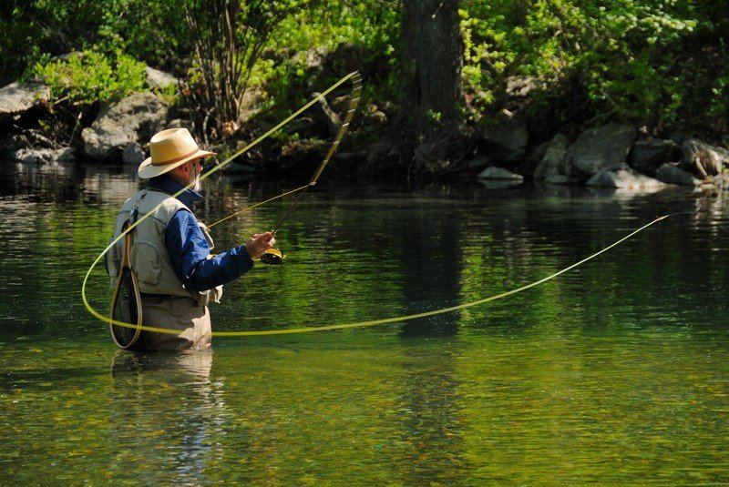 man casting fly rod